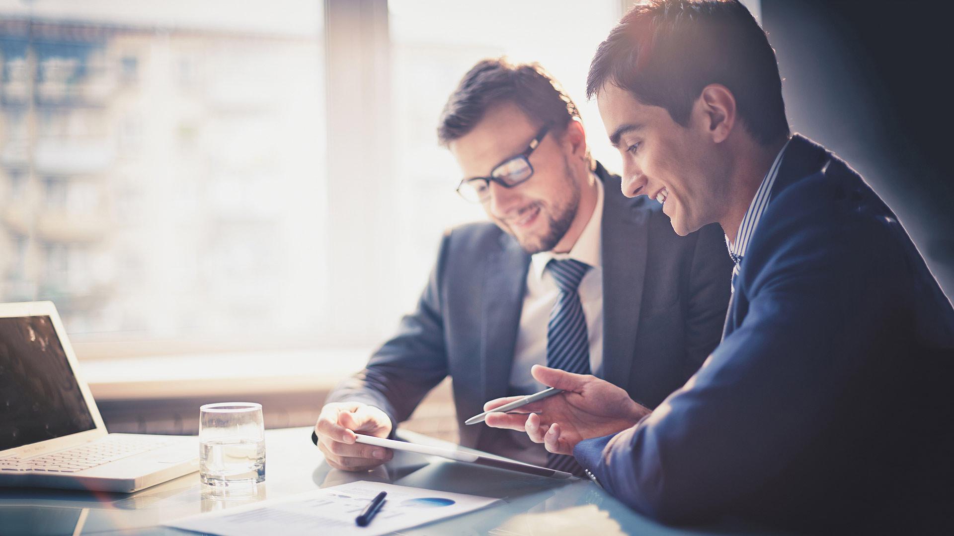Two businessmen analyzing data