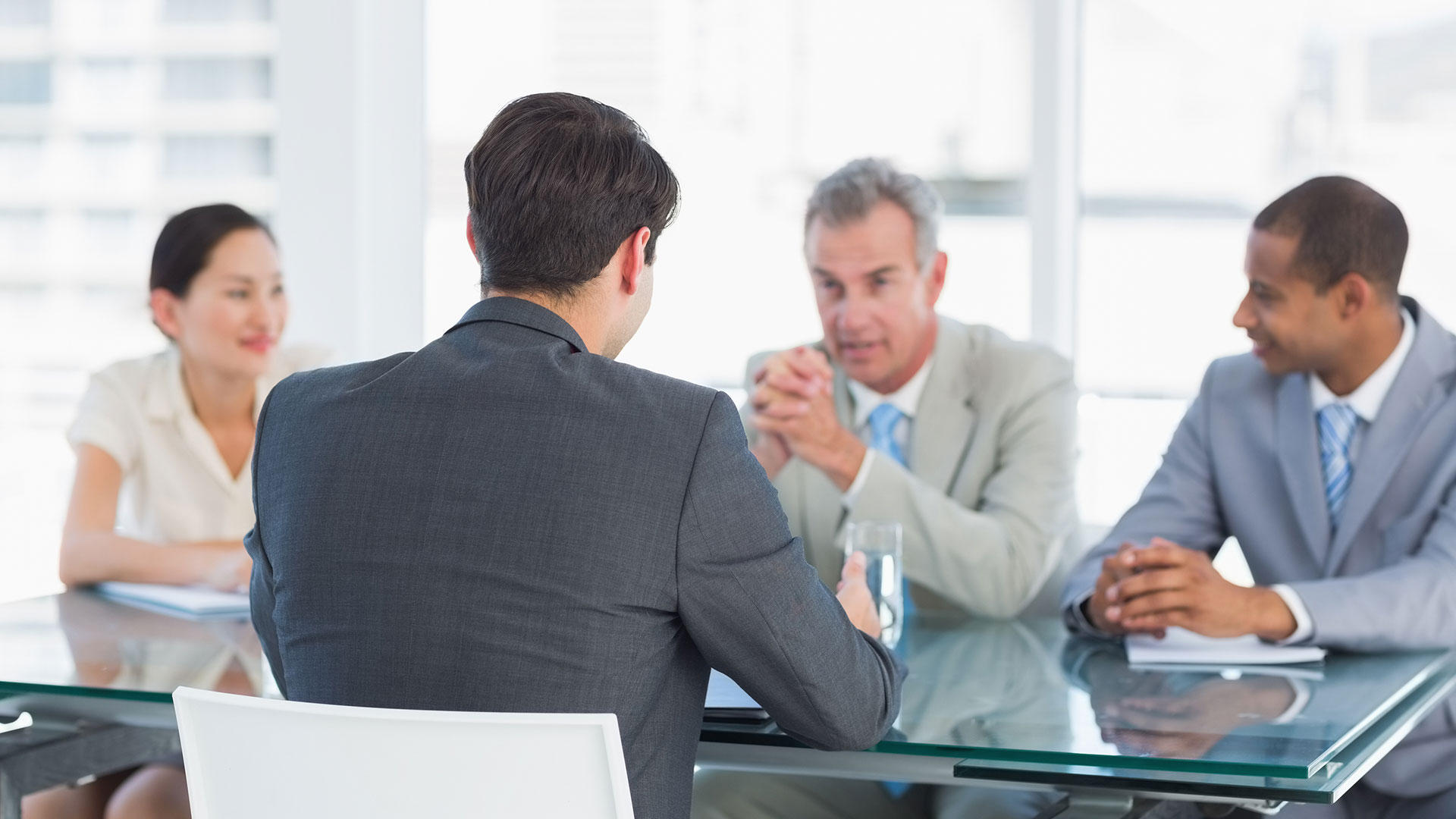 Man talking with human resource representatives
