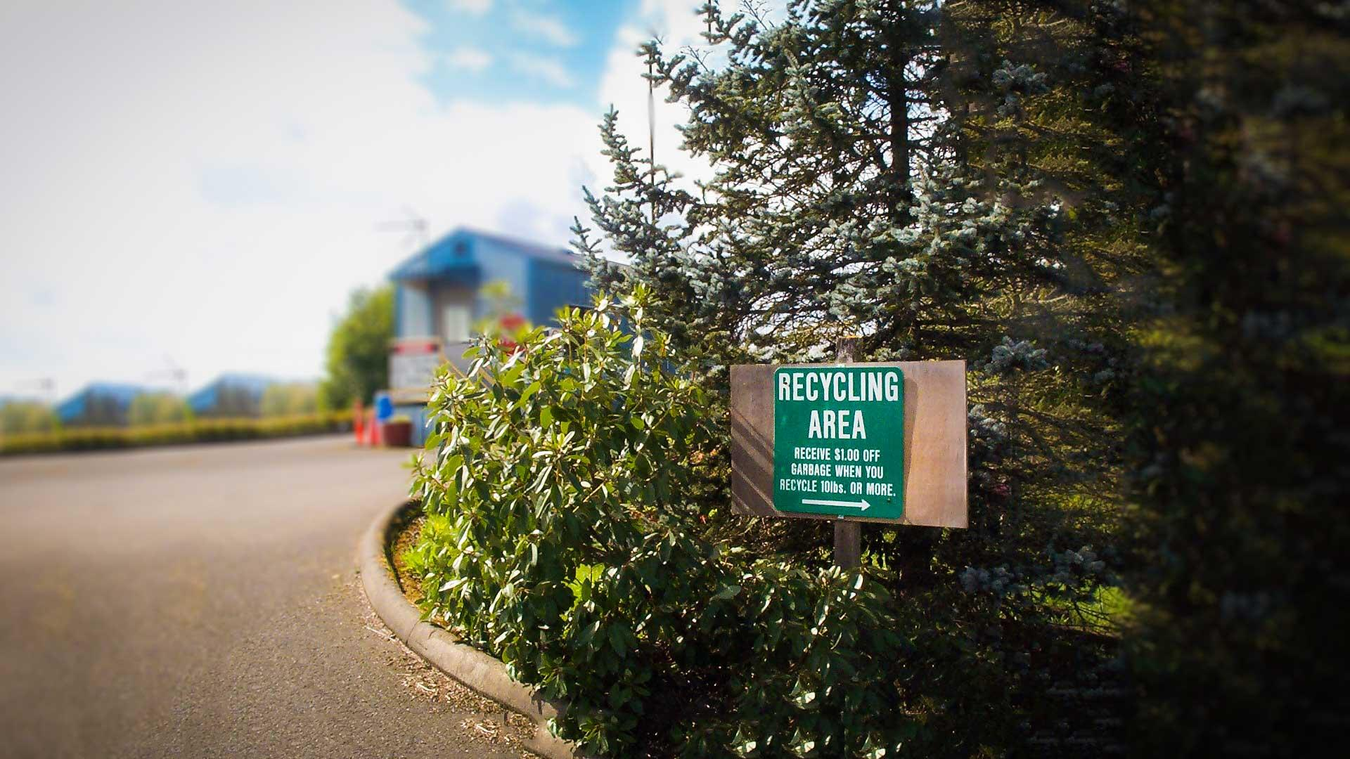 Recycling sign in front of a recycling center