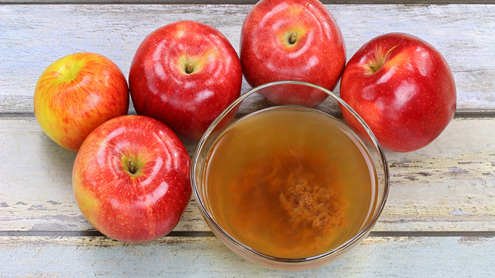 Apples surrounding hard cider