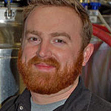 Daniel Vollmer standing in a brewery.
