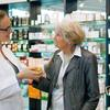 Pharmacist helping elderly woman