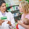 Two woman at pharmacy, baby, perscription